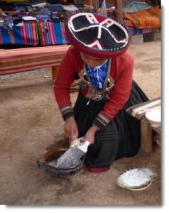 Sthefany Huanca from Centro Textil Andina Kuska Away Yachak demonstrates the preparation of saqtana root, a natural detergent