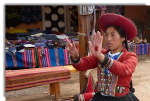 Sthefany Huanca from Centro Textil Andina — Kuska Away Yachak demonstrates the natural deep red of cochinilla