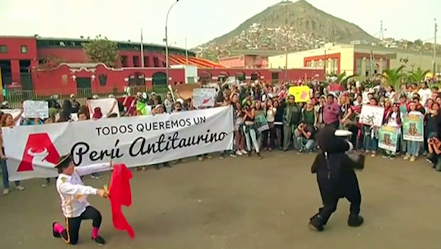 Anti-bullfighting protesters demonstrate outside the Plaza de Toros de Acho bull fighting ring in Lima, Peru