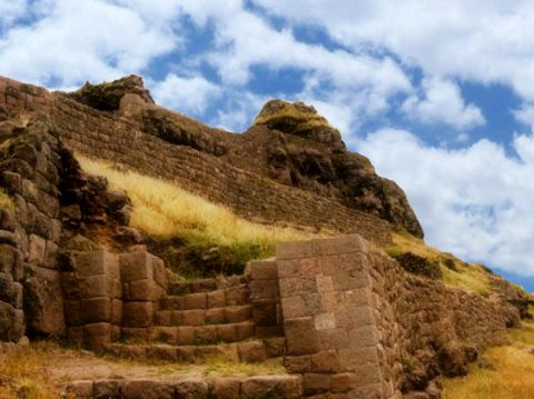 The Waqrapukara sanctuary features fine Inca stonework melded into the natural landscape.