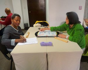 Julia Scruggs and Celia Dayrit Thompson participate in the opening of the Scrabble tournament, combined with luxury Peru tour, starts in Lima's Miraflores district.