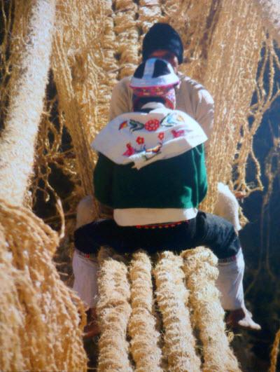 Weaving the Q'eswachaka bridge ~ © 2010 Peru National Institute of Culture