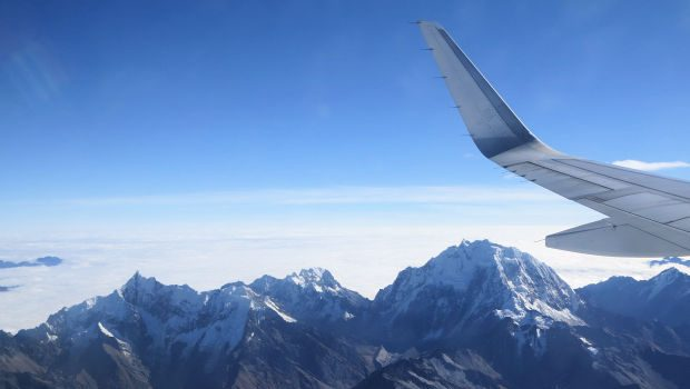 Best airline for stunning ice peak mountain views during flight to Cusco