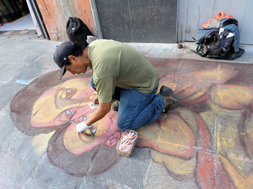 Lima street artist at work