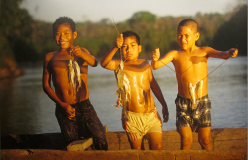 children fishing in the Amazon rain forest