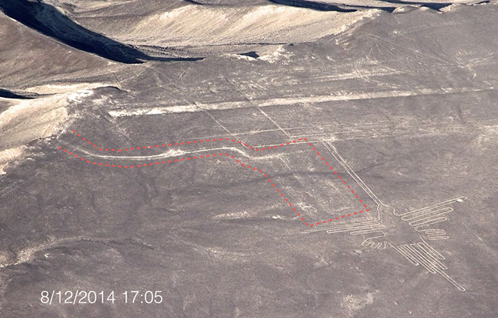 Red line demarcates damage allegedly caused by climate activists during their march to the iconic Hummingbird at the Nazca Lines