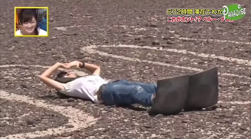 Reporter for a Japanese variety show laid on her back between the toes of  the iconic Nazca Hummingbird geoglyph
