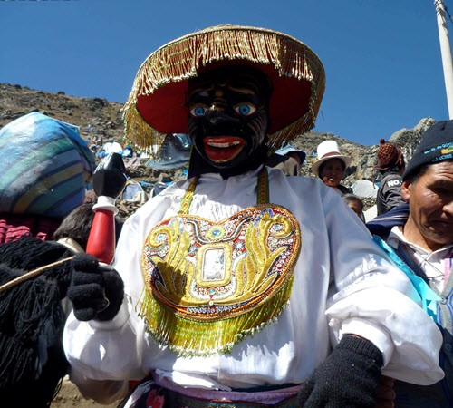 "A traditional dancer at the high mountain festival of the Qoyllur Rit'i (or ""Snow Star"" in Quechua)"