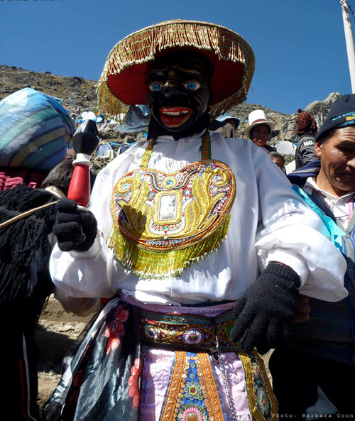 """A traditional dancer at the high mountain festival of the Qoyllur Rit'i (or """"Snow Star"""" in Quechua)"""