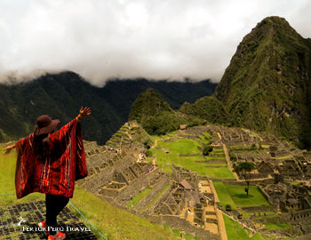 A visitor extols the view overlooking the Machu Picchu Sanctuary on the day of the Southern Hemisphere's Summer Solstice, Friday, Dec. 21, 2018
