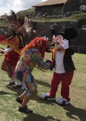 Mickey Mouse looking spry for an 88-year-old rodent, as he participates in a traditional dance on the esplanade of Sacsayhuaman, in Cusco, Peru