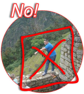 A misbehaving tourist demonstrates what how NOT TO BEHAVE during a tour of Machu Picchu. Be respectful of this World Heritage Site.