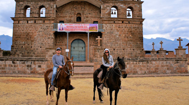 Dan and Juliana on a horseback tour in the Sacred Valley during their Cusco honeymoon
