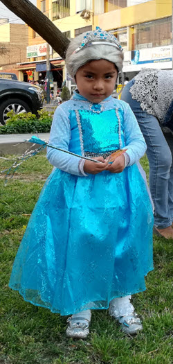 A little Peruvian girl dressed up as fairy princess prepares to go trick or treating for Halloween in Lima Peru