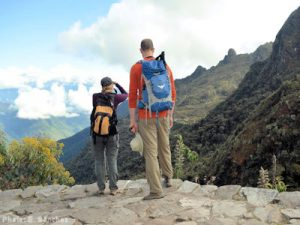 A couple stop to take in the view and take photos during their hike of the Inca Trail, which Peruvian authorities hope to have internationally certified among sustainable tourism destinations.