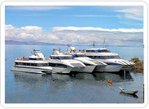 Yachts moored on Lake Titicaca for a Peru tour.