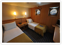 Comfortable Superior Cabin aboard the M/V Galapagos Legend.