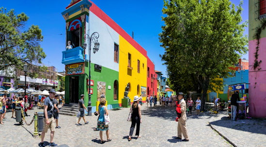 Visitors walking through the colorful streets of La Boca district of Argentina