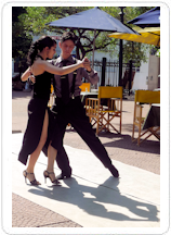 Dancers do a tango at an outdoor cafe in Buenos Aires, Argentina