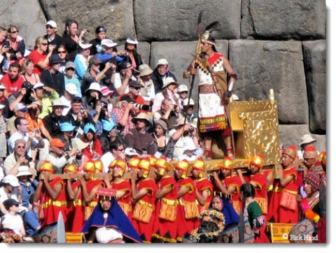 The Sapa Inca (Great Inca) is carried before crowds of spectators at the Inti Raymi festival in Cusco, Peru