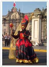 A costume street party outside Lima's Government Palace, where visitors come each day at noon to see the changing of the guard.