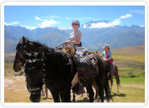 Horseback riding Cusco: Two women riding Peruvian Paso horses on an equestrian tour in Cusco's Sacred Valley