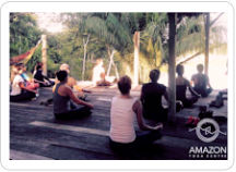 A group meditation class during an outdoor morning session at the Amazon Yoga Center, just outside Puerto Maldonado