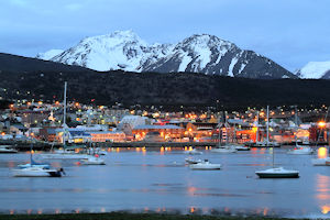 The Bay of Ushuaia at twilight, the city lights sparkling and boats on the water